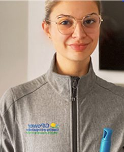 Classy woman in grey sweater - Co-Founder of GPower cleaning services