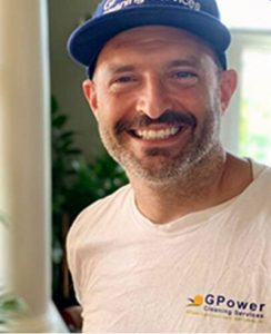 Smiling man in baseball cap - Co-Founder of GPower cleaning services