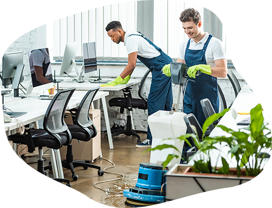 Three cleaning technicians wiping down an open office