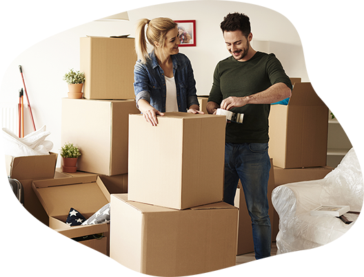 Man and woman packing boxes after move out cleaning